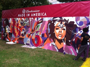Artist Keir Johnston finishes a mural that was painted by concert attendees via paint by numbers at the Made in America festival last weekend.