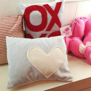 Hand-made Love pillows are available at BEAdazzle at the Community Arts Center in Wallingford.